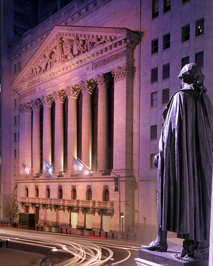 The New York Stock Exchange and statue of General George Washington at night